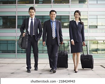 business people traveling with luggage.