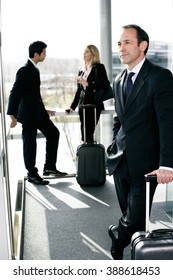 Business people traveling, waiting in airport or station