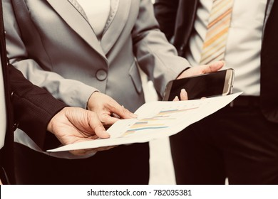 business people trust in team using mobile and paperwork to discuss information with a colleague waiting meeting. Business woman,Business Performance Review with Bank representative For investment