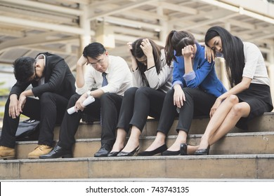 Business people unemployed from company sit on street, unemployment concept