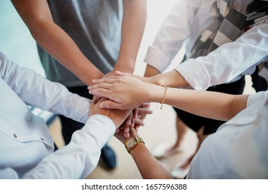 Business people with unity working together teamwork for success of the business.