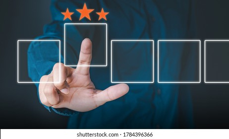 Business people use the index finger to touch the virtual screen to select the starred icons, future digital technology working in digital form, business strategy concepts, human business concepts.