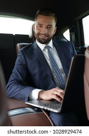 Business people use a laptop