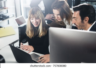 Business people using computers and laptops. Coworkers working together in modern office.Horizontal.Blurred background