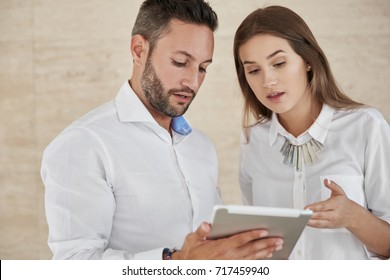 Business people using tablet discussing
