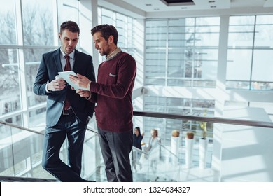 Business people using technology during their office break