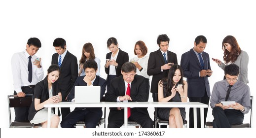 Business people using their communication devices while ignore each other in meeting