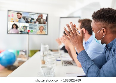 Business people in a video conference or during live streaming on monitor