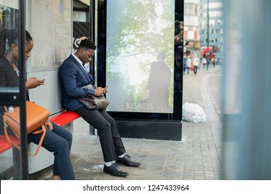 Business people waiting at a bus stop