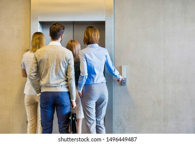 Business people waiting for elevator in office