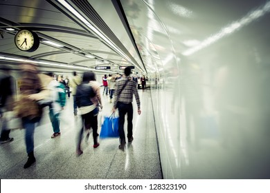 business people walk at subway station abstract blur