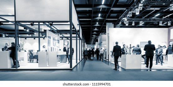business people walking between trade show booths. ideal for websites and magazines layouts
