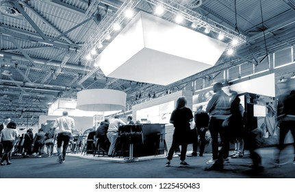 business people walking between trade show booths at a public event exhibition hall