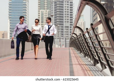 Business people walking at big city talking conversation happy successful.