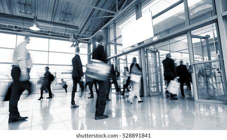 Business People Walking at a European Trade Fair