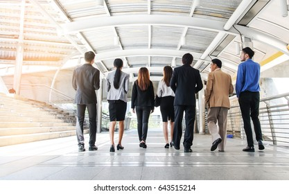 Business people walking forward, modern city background, Business Teamwork concept.