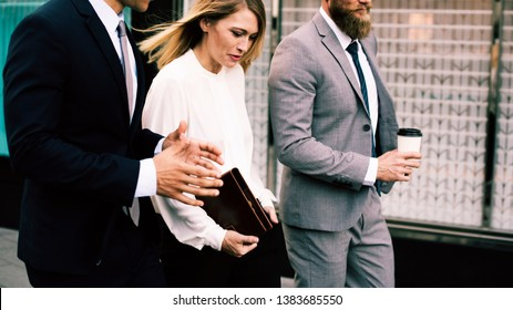 Business people walking and having a conversation