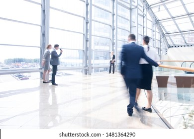 Business people walking in a modern hall of office building