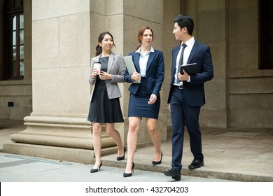 Business people walking at outdoor together