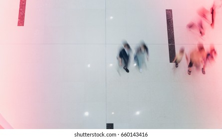 business people walking in shopping mall blur motion