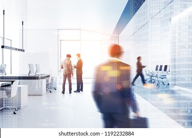 Business people walking in a white office with panoramic windows, white walls and open space area with computer tables. Toned image double exposure blurred