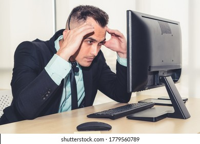 Business people wearing headset feel unhappy working in office . Failure negative sadness emotion concept of call center, telemarketing and customer support crisis in financial economy down fall .