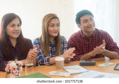 Business people wearing plaid shirt applauding after listening report at seminar or conference and creating the next value concept,Professional presentation or coaching,Chief and businessman team,