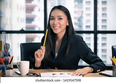 Business people or woman or professional lady officer sitting and thinking and working in office