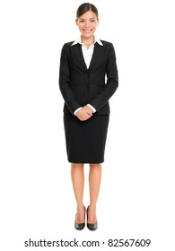 Business people - business woman standing in full body smiling happy at camera isolated on white background