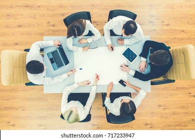 The business people work with a blank sheet on the table. view from above