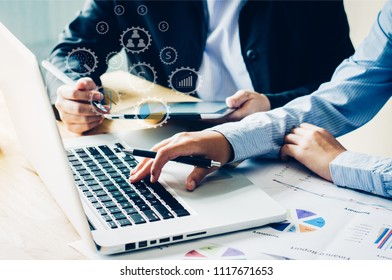 Business people work together to analyze problems, discuss business approaches with tablet, laptops, and office documents ,icon for work