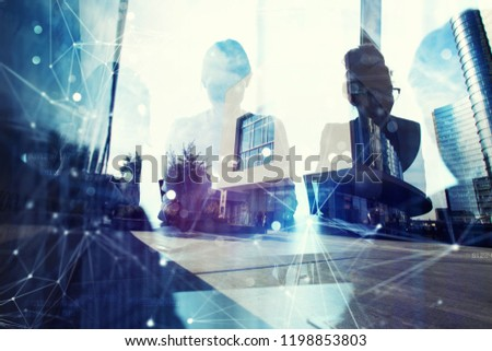 Business people work together in office. Concept of teamwork and partnership. double exposure with network effects