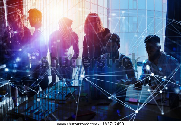 Business people work together in office with internet network effects. Concept of teamwork and partnership. double exposure