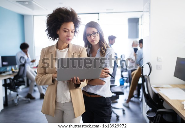 Business people working and brainstorming in office