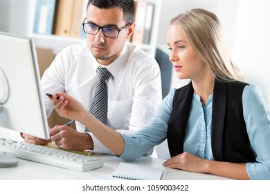 Business people working with computer in an office