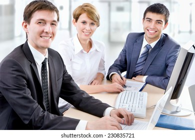 Business people working at a computers in the office