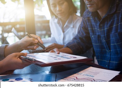 Business people working with financial plan at office