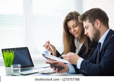 Business people working with laptop at office