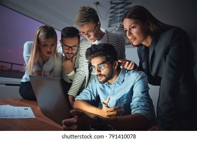 Business people working late together