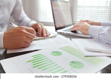business people working in the office, focus on foreground