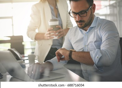 Business people working in office. Business man looking at clock an waiting something.