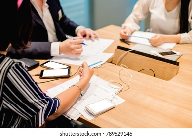 Business people working on laptop computer and phone in meeting room