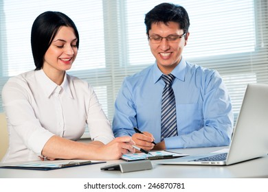 Business people working on their business project together at office