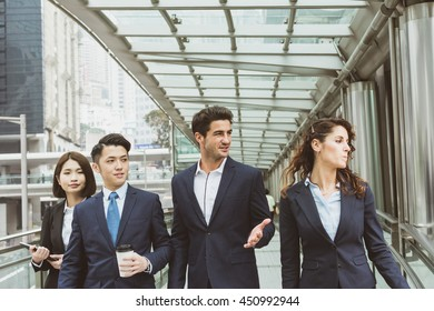 Business people working outside office