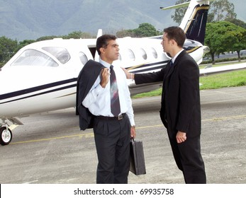 Business people working at private jet.