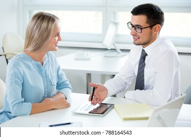 Business people working with tablet computer in an office