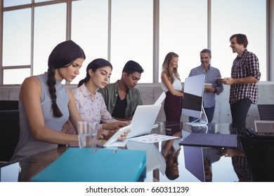 Business people working together at creative office desk