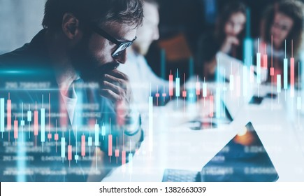 Business people working together at night office.Technical price graph and indicator, red and green candlestick chart and stock trading computer screen background. Double exposure.