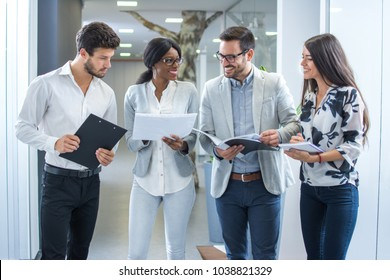 Business people working together in office hall.