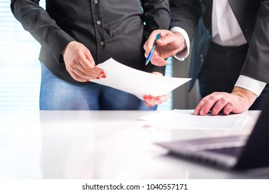 Business people working together in office. Project manager and assistant reporting sales. Negotiation, discussion and teamwork concept. Financial team brainstorming. Two professionals talking.